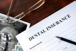 Dental insurance form on the wooden table